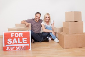 Couple sitting after selling their house