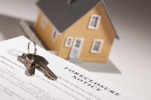 Foreclosure Notice Concept with Model House and Keys